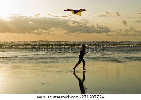 Flying a kite at the beach in Newport, Oregon. - stock photo