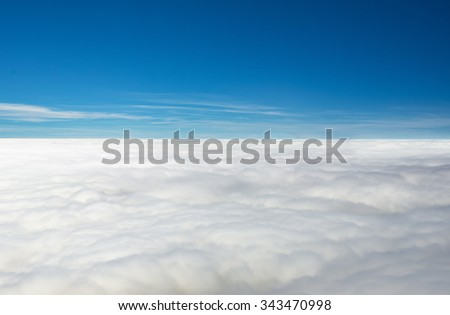 Flying above the clouds - stock photo