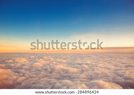Flying above the clouds. view from the airplane, soft focus - stock photo