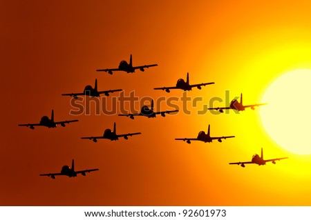 Flying at sunset - stock photo