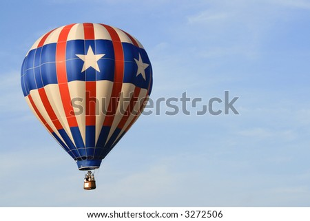 Flying balloon with the american flag colors