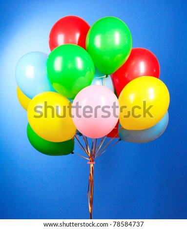 Flying balloons on a blue background