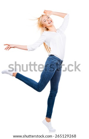 Flying beauty. Full length of beautiful mature women posing and smiling while standing against white background - stock photo