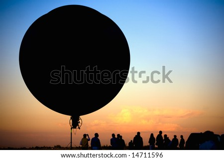 flying blimp silhouette - stock photo