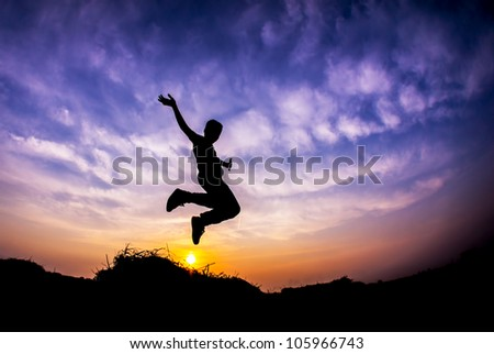 Flying boy during sunset in Silhouette