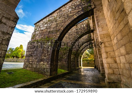 Flying buttress of the church of Santa Maria la Real del Sar in Santiago de Compostela. - stock photo