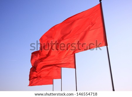 flying Chinese red flags - stock photo