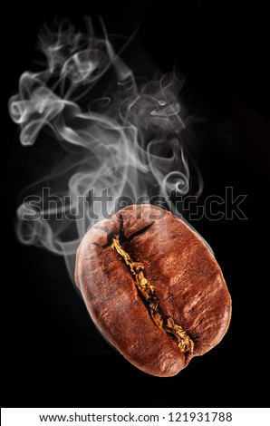 Flying coffee bean in smoke, isolated on black background - stock photo