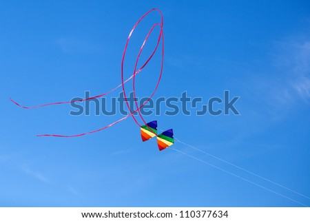 flying colorful double kite in the air