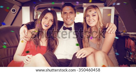 Flying colours against pretty girls with ladies man in the limousine - stock photo