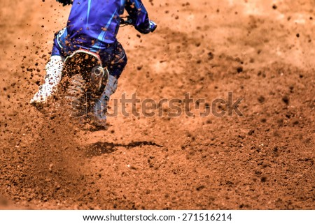 Flying debris from a motocross in dirt track - stock photo