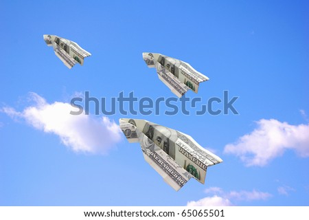 Flying dollars - stock photo