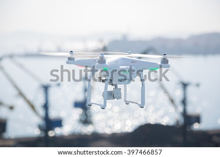 Flying drone with a camera on the sky
