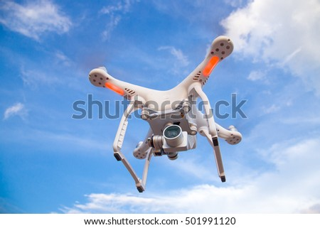 Flying drone with stabilizer camera on the sky.Drone and blue sky.