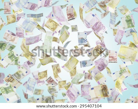 Flying EURO notes over blue background. - stock photo