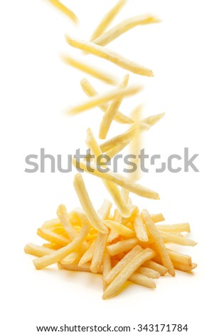 Flying fried potatoes - stock photo