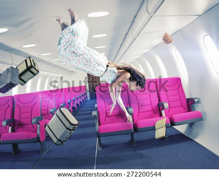 Flying  girl in an airplane. Creative concept  - stock photo