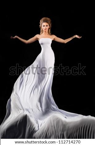 Flying girl in long white dress - stock photo