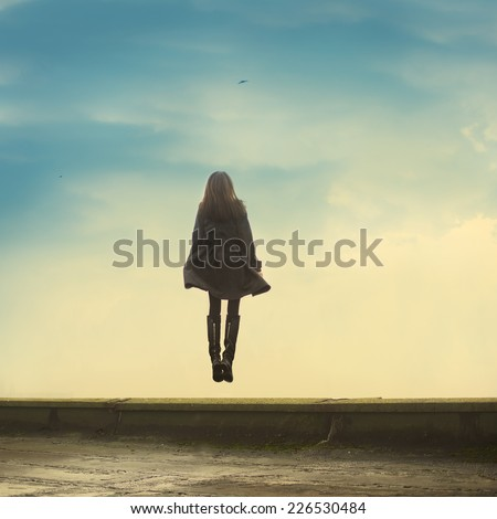 Flying girl on a background of vanilla sky - stock photo