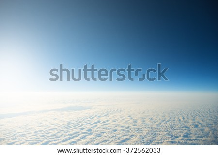 Flying high above clouds