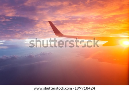 Flying in the sky and the sea of clouds. - stock photo