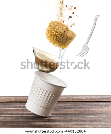 Flying instant cup noodle on white background