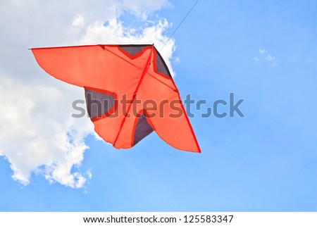 flying kite in the air against the blue sky