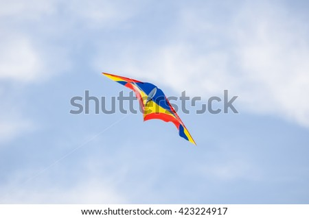 Flying kite on blue sky