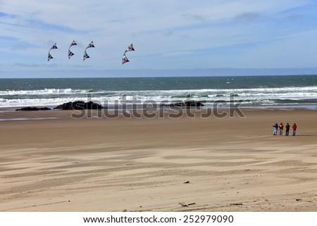 Flying kites on the beach Oregon Coast. - stock photo
