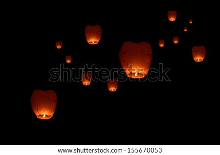 Flying lantern in the dark sky
