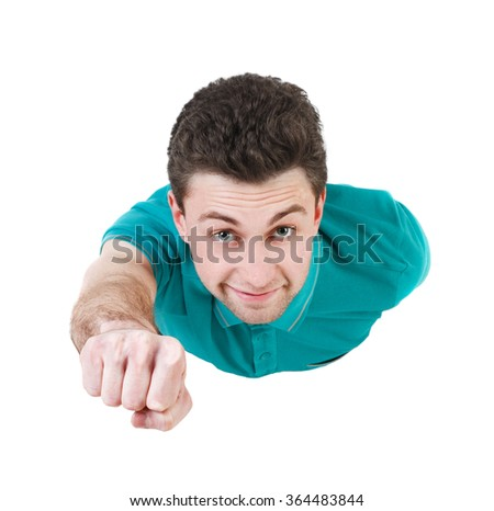 Flying man front view. Smiling curly-haired guy is flying in Superman pose.   Isolated over white background.  - stock photo