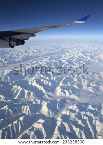 Flying over Chukotka mountains in Siberia, Russia - stock photo