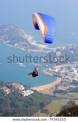 Flying over Hong Kong - stock photo