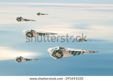 Flying paper planes with dollar banknotes, on blue cloudy sky background.