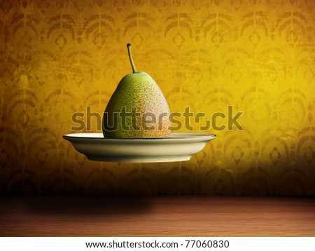 flying pear on a plate - stock photo