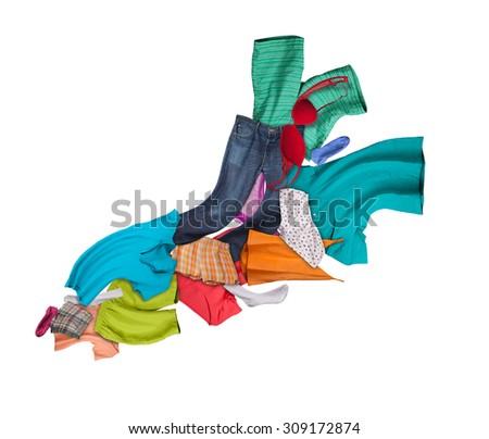 Flying pile of clothing isolated on white background - stock photo