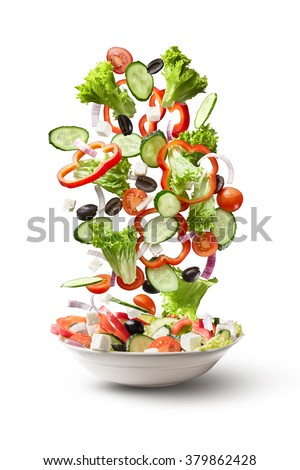 flying salad isolated on white background. Greek salad: red tomatoes, pepper, cheese, lettuce, cucumber and olives