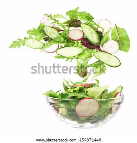 Flying salad. Isolated over white. Shallow dof  - stock photo
