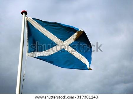 Flying Scottish Flag on Flag pole - stock photo