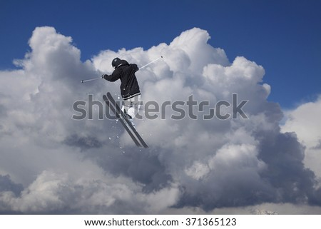 Flying skier on mountains. Extreme ski sport.