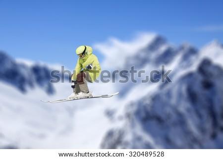 Flying skier on mountains, extreme sport - stock photo