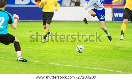 Flying soccer player during the soccer match - stock photo