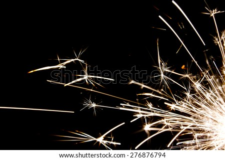 Flying sparks from a sparkler - stock photo