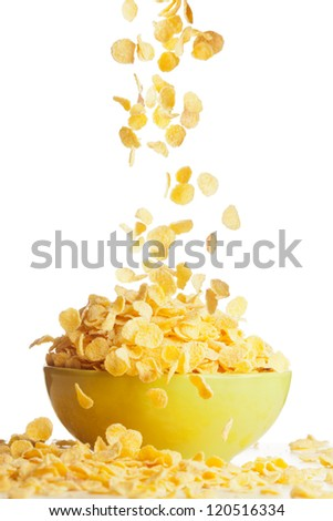 Flying to the bowl corn flakes isolate on white - stock photo