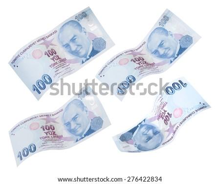 Flying 100 Turkish Liras on white background  - stock photo