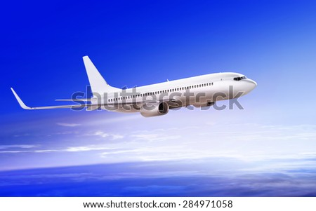 flying-up white passenger airplane in the sky at sunrise - stock photo