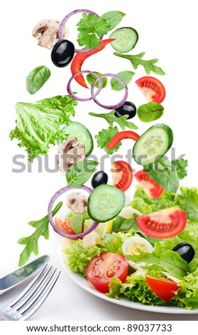 Flying vegetables - salad ingredients. Isolated on a white background. - stock photo