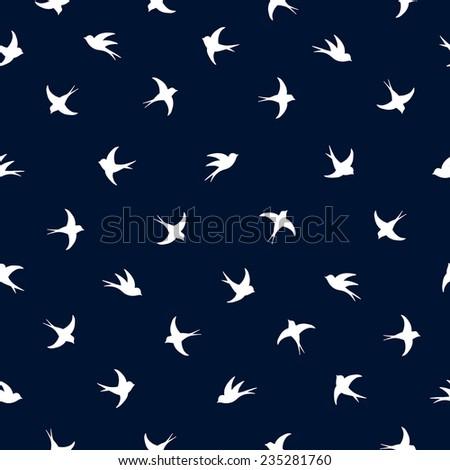 Flying white outline birds pattern on dark blue background jpg file - stock photo