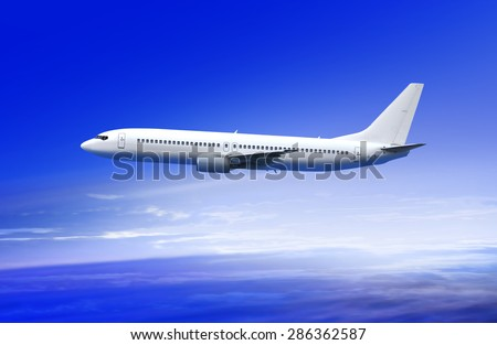 flying white passenger plane in the sky at sunrise