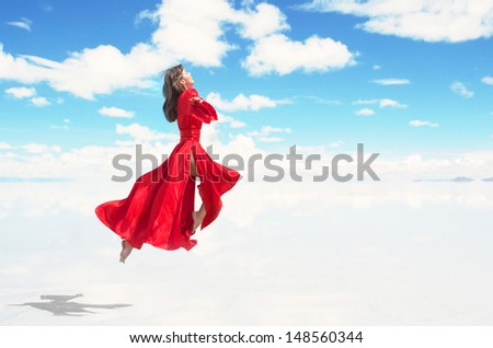 Flying woman in red kimono - stock photo